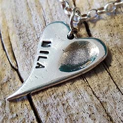 Swoop Heart Charm